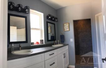 Master Bathroom w/ walk-in shower and raised dual vanities